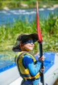 Boy kayaking on the river — Stock Photo