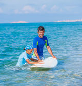 Girl with surf — Stock Photo