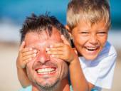 Boy with father playing at the beach — Stock Photo