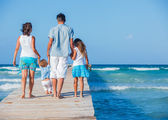 Family walking wooden jetty — Stock Photo