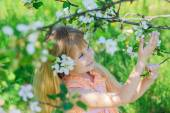 Girl in blooming apple tree garden — Stock Photo