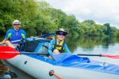 Boy with his father kayaking — Stock Photo
