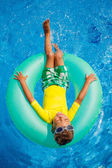 Little boy relax in pool — Stock Photo