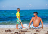 Boy with father surfing — Stock Photo