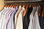 Dress shirts on hangers — Stock Photo