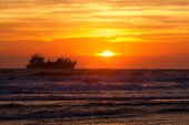 Ship silhouette on North sea at sunset — Stock Photo