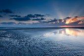 Sunrise over North sea coast at low tide — Stock Photo