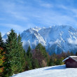 Hut on snow meadow in winter Alps — Stock Photo #57539741