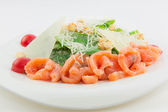 Caesar salad with salmon, tomato, cheese and crumbs — Stock Photo