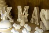 Composition with letters XMAS and christmas toys on wooden shelf — Stock Photo