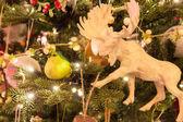 Christmas tree with christmas deer toy — Stock Photo