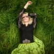Sexy blonde woman lying in high grass — Stock Photo #52302961