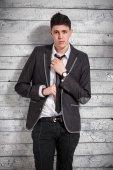 Portrait of elegant italian man in suit adjusting tie — Stock Photo