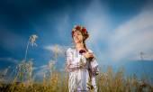 Beautiful ukrainian girl with braid posing at field — Stock Photo