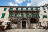 Stone palace at sunny day in city of Kotor — Stock Photo