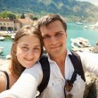Young happy couple posing against sea bay at sunny day — Stock Photo #55210089