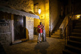 Beautiful romantic coupe hugging on street of ancient city — Stock Photo
