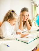 Confused mother looking at daughters homework — Foto de Stock