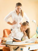 Mother being angry of daughter sleeping on desk while doing home — Stock fotografie