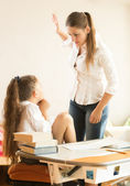 Angry mother hitting intimidated daughter — Stock Photo