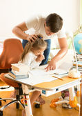 Father angry at daughter doing homework — Foto de Stock