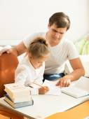 Man pointing on mistake at daughters notebook — Foto de Stock