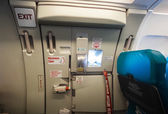 Emergency exit door in airplane — Stockfoto