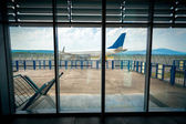 View from inside of airport on the plane on runway — Stockfoto