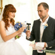 Bride and groom holding glasses of champagne — Stock Photo #57590241