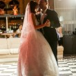 Just married couple dancing at dark hall a beam of light — Stock Photo #57591467