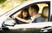 Happy bride and groom riding a car — Foto de Stock