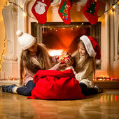 Two little girls having a fight of present on Christmas — Stock Photo