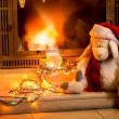 Toy sheep sitting next fireplace at new year — Stock Photo #57973977