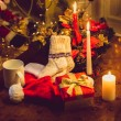 Toned photo of christmas candles, open giftbox and woolen socks — Stock Photo #57974147