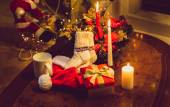 Toned photo of christmas candles, open giftbox and woolen socks — Стоковое фото