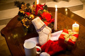Table decorated with candles, and christmas decorations — Stock Photo