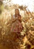 Cute brunette woman walking at field — Stok fotoğraf
