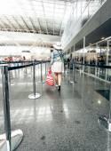Rear view of woman walking at airport terminal — Stock Photo