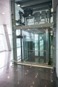 Glass elevator for disabled people at international airport — Stock Photo