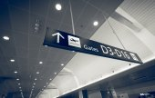 Toned shot of gate sign in airport terminal — Stock Photo