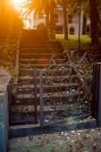 Toned photo of old stone stairs leading to villa — Stock Photo
