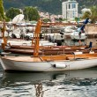 Old wooden boat used for touristic trips moored at sea harbor — Stock Photo #58640561