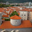 City of Budva with red tiled roofs and big orthodox church — Stock Photo #58641839