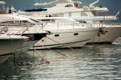 White luxury yachts and boats moored at sea harbor  — Stock Photo