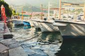 Toned photo of row of moored fishing boats — Stock Photo