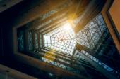 Photo of modern building atrium with shining sun — Stock fotografie