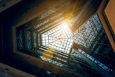 Photo of modern building atrium with shining sun — Stock Photo