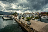 Landscape of sea port with moored yachts at rainy day — Stock Photo