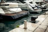 Row of moored yachts at rainy day — Stock Photo
