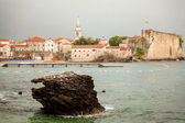 Old seaside city of Budva with high stone walls and towers — Stock Photo